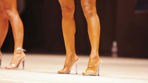 Beautiful female demonstrating fit legs and healthy body on stage at competition Footage