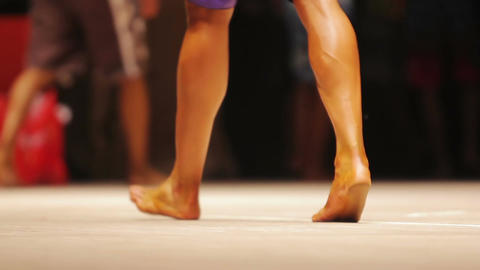 Feet of male bodybuilders walking on stage, legs of fitness contest participants Live Action