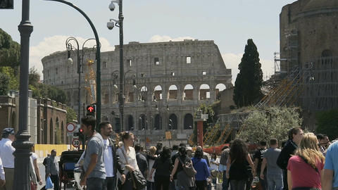 Slow motion of many people walking near Colosseum, tourist flow to summer Rome Footage