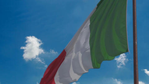 Italian national flag against blue sky background,... Stock Video Footage