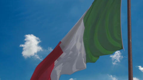 Italian national flag against blue sky background, tricolour symbol of country Live Action