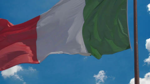 Flag of Italy waving in wind proudly, blue sky... Stock Video Footage