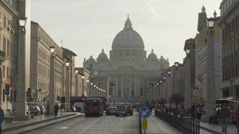 Many people and transport heading for Vatican City, famous landmark in Rome Live Action