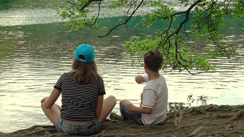 Children on the Shore of Lake. Slow Motion Filmmaterial