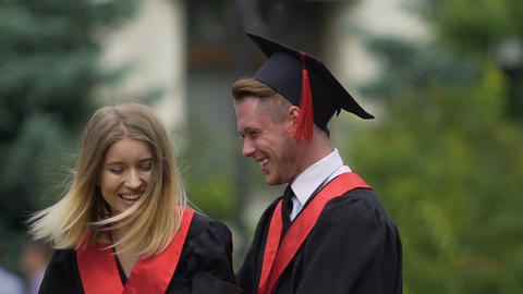 Tender couple of graduating students hugging, dreaming of successful future Live Action