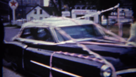1965: 'Just Married' classic black Buick car decorated for newlyweds Footage