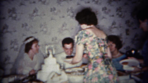 1965: Wedding reception food served at newlyweds table Footage