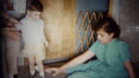 1959: Kids play model train set circle loop toy Footage