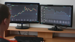 Man works on the financial market (exchange) on computer Footage