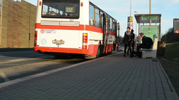 PRAGUE, CZECH REPUBLIC - APRIL 2014: Busy street and the bus stop with people (t Footage