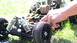 Man prepares a toy car for a speed contest 01 Footage