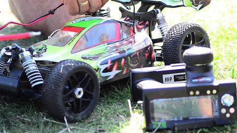Man prepares a toy car for a speed contest. engine starts 02 Footage
