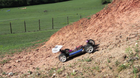 Toy car climbs a steep slope amber color Footage
