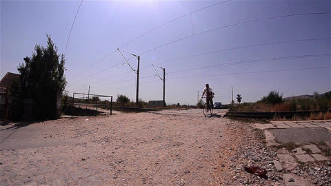 Bicyclist passing on a railroad crossing signaled acoustically Footage