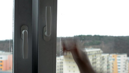 Hand opens and closes a whole window (close up) - houses in background Footage
