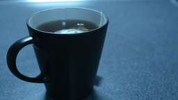 Cup Of Hot Tea On Kitchen Counter stock footage