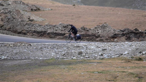 Cyclist pedaling a mountain asphalted road 1 Footage