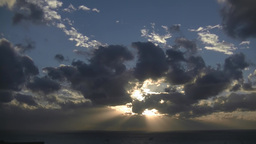 Timelapse; Very cloudy sunset over the ocean Footage