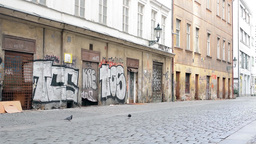 PRAGUE, CZECH REPUBLIC - MARCH 2014: Dirty old streets with graffiti art Footage