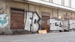 PRAGUE, CZECH REPUBLIC - MARCH 2014: Dirty old streets with graffiti and cigaret Footage