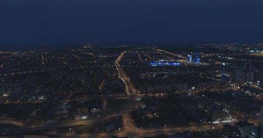 Illuminated streets of a city at night. Aerial