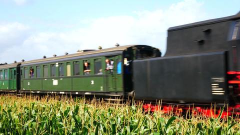 Old steam locomotive pulling railroad passenger cars Footage
