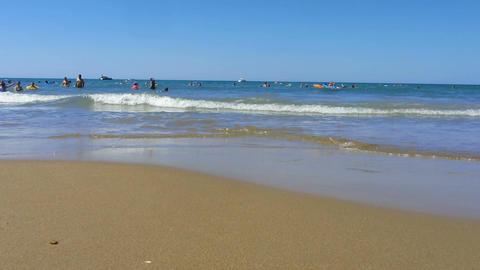 Satisfied crowd of people splashing in waves of warm summer sea, vacation Footage