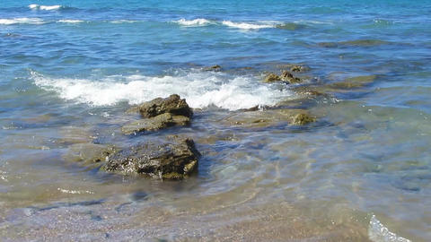 Small sea waves washing the stones near coastline, clear water, relaxation Footage