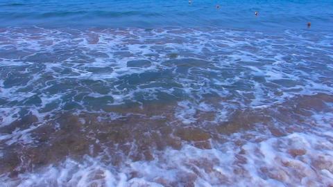 Foamy sea waves rolling on sandy beach, relaxing scene for meditation, summer Footage