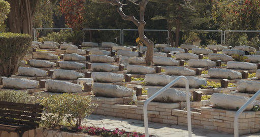 graves and tombstones at a military cemetery in Israel Footage