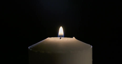 Slow motion Close up shot of a large white candle Footage