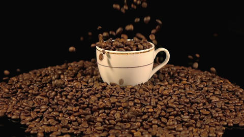 Video of falling coffee beans into mug in real slow motion Live Action