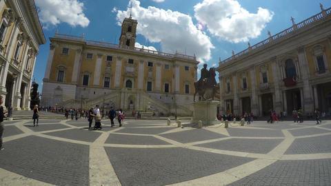 Equestrian statue on Piazza del Campidoglio in Rome, famous touristic place Live Action