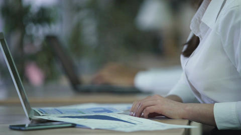 Young female manager overloaded with paper work, has to meet tight deadline Footage