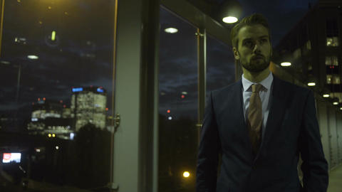 Business person walking in city at evening Footage