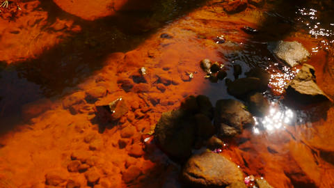 Stream water full of red ferric sediments. Cascades in…, Live Action