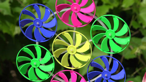 colorful windmill toy in summer garden, 4 K Footage