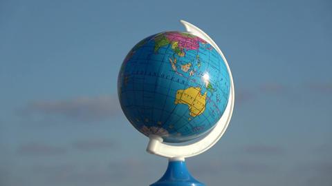 globe sphere map rotating on blue sky background, 4K Footage
