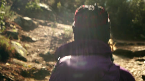 Track shot of woman walking in the forest Footage