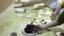 Baker prepares baking dessert pastry HD bakery video. Chocolate on croissant Footage