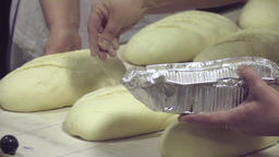 Raw bread loaves before baking at bakery HD slow-motion video. Production Footage