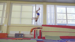 Gymnast training gymnastic somersault HD video. Athlete vault hand salto