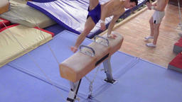 Gymnast doing exercises on pommel horse HD slow-motion video. gymnastics Footage