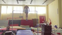 Gymnast exercises on high horizontal bar HD video. Athlete training gymnastics Footage