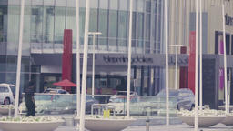 Arabian mall modern exterior Dubai city street road HD video. Traffic entrance