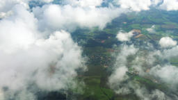 Flying over countryside village terrain through clouds HD aerial video. Top view Footage