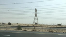 POV driving on desert arabian highway road HD video. Electric power lines towers Footage