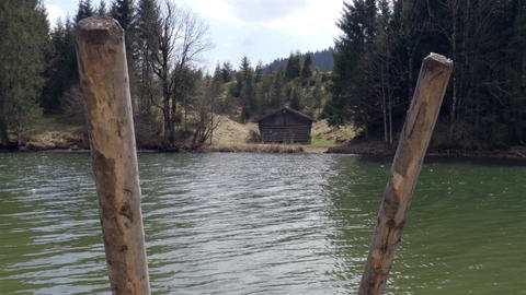Small pier on the Lake with the house on the background Footage