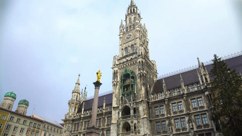 Beautiful view on Mary's Square, tourists photographing New City Hall in Munich Footage