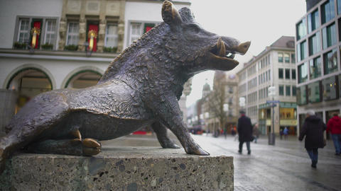 Bronze statue of wild boar standing near Hunting and Fishing Museum in Munich Footage